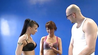 Two skinny babes suck and fuck with bald guy in the gym